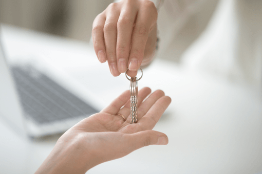 Estate agent gives keys to new landlord