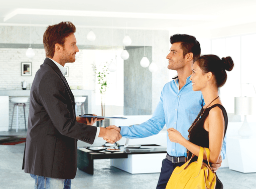 Estate agent shows prospective buyers around the house